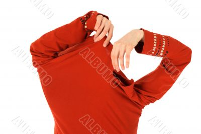 Funny woman takes off an orange shirt