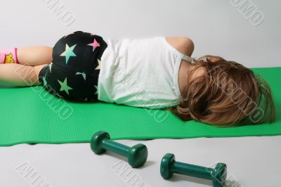 Small girl is tired to make power training.