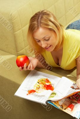 The attractive Girl & red apple