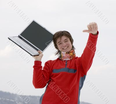 Happy teens student with laptop in hand