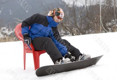 Teens snowboarder in bandanna