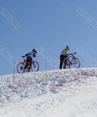 Couple of professional bikers in mountains
