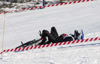 Snow biker downhill after accident in winter