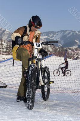 Biker in helmet in winter mountains Tien Shan