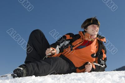 Teenager boy with player in winter mountains