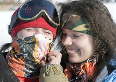 A lifestyle image of two young snowboarders