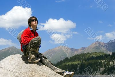 Teenager boy in sport pullover in mountain hike