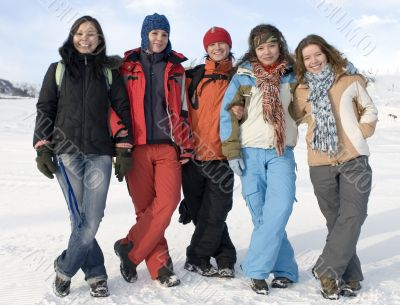 Group of sports teenagers in winter mountains
