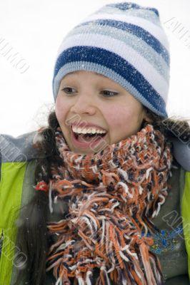 Laughing beautiful girl snowborder