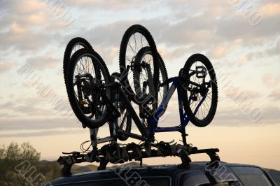 Sports bicycle over jeep
