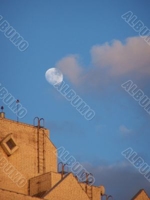 Moon, sky, clouds, and roof.