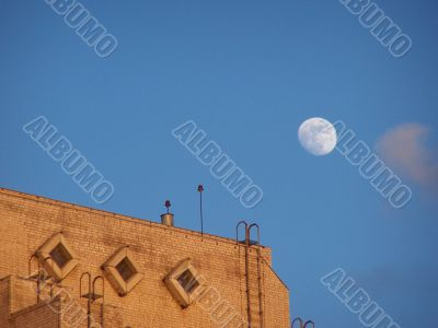 Moon, sky and roof.