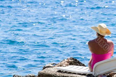 model relaxing on beach