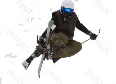 Freestyle. Snow Skier Jumping over white.