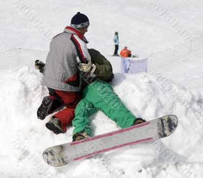 Accident with athlete snowboarder at contest