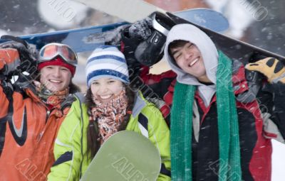 Group of teenagers snowborders in mountains