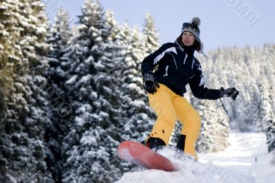 A health lifestyle image of snowboarder girl