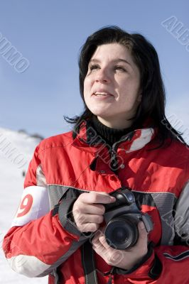Attractive woman holding a camera