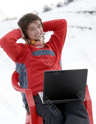 Happy teens student with laptop in winter