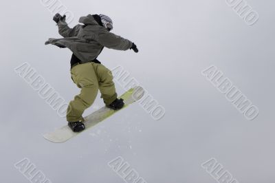 Jump of teens rap snowboarder over sky