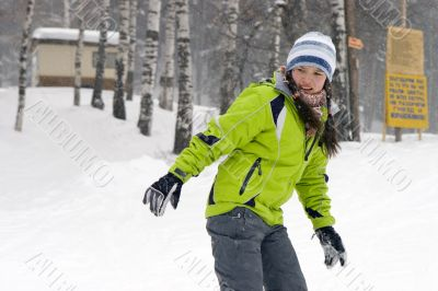 A health lifestyle image of young snowboarder girl