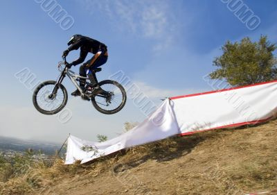 Biker jump in mountains,  Competition