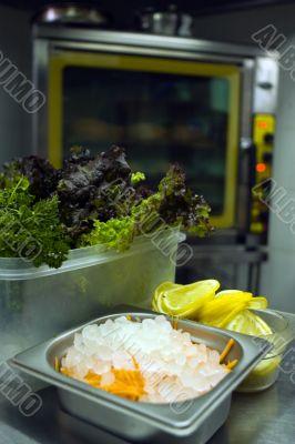 Kitchen, chrome stove; broken ice and lemon