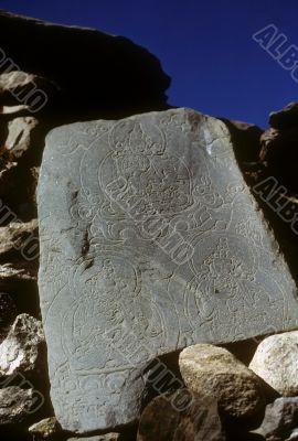 Mani stones with Buddhist figures