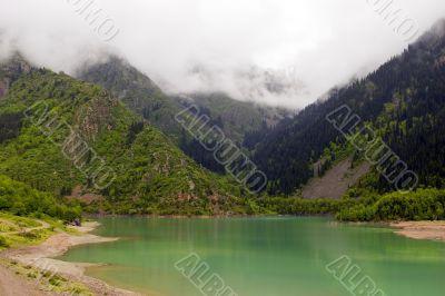 Green lake. Rain. Fog.