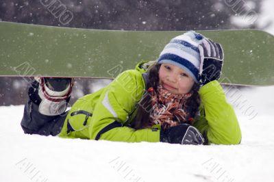 Laughing beautiful girl snowborder, snowfall