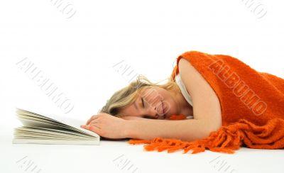 Girl fallen asleep with a book