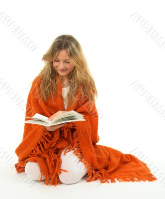 Girl reading a book, smiling