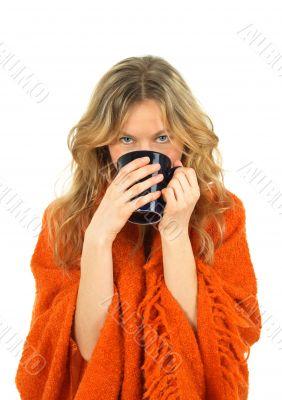 Cozy girl enjoying a cup of tea