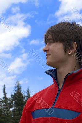 European teen boy in red sport pullover