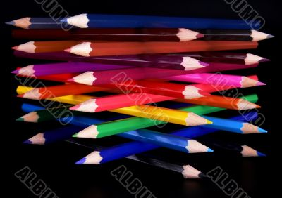 Colorful pencils tower top view
