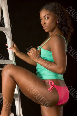 Sexy African-American girl by ladder