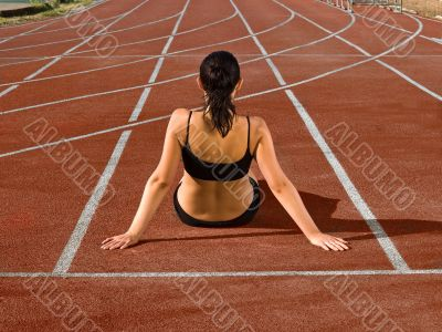 young woman at stadium track