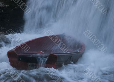 Boat in waterfall