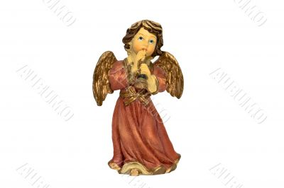 Christmas angel figure playing horn