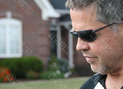 man in suburban scene