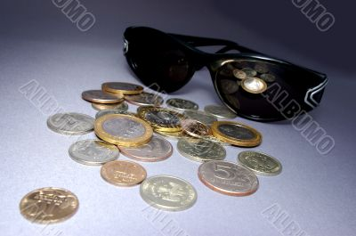 The Coins and spectacles.
