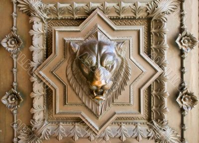Lion head bas-relief