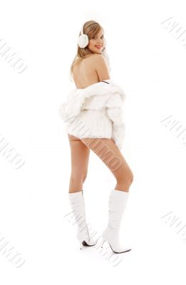 blonde in boots, fur and headphones