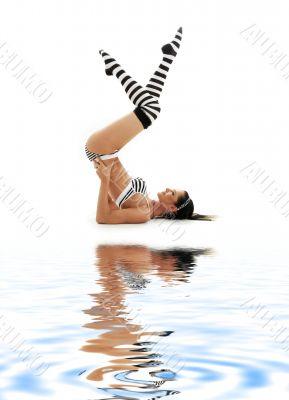 striped underwear shoulderstand on white sand 2