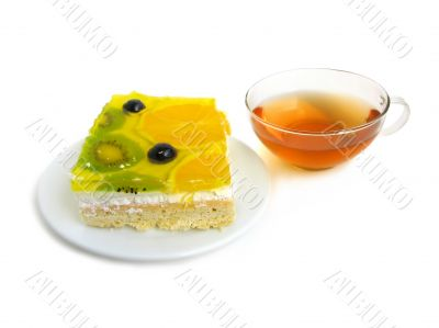 Fruit tart with tea cup
