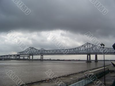 Bridge over river in cloudy weather