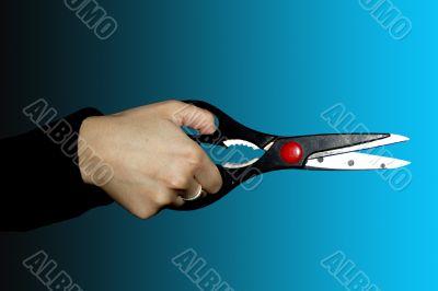 scissors on black-blue background