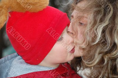 mom and son kiss