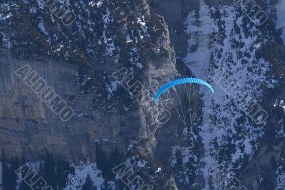 Flying paraglider