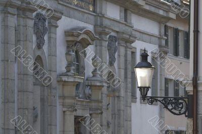 Old lantern on the medieval street in Switzerland.